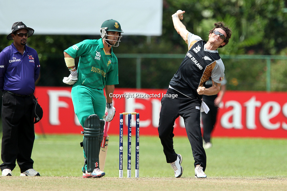 Rob Nicol bowls as JP Duminy prepares to run during the ICC Twenty 20 World Cup warm up match between New Zealand and South Africa held at the Colts Cricket Club in Colombo, Sri Lanka on the 17th September 2012<br /> <br /> Photo by Ron Gaunt/SPORTZPICS/PHOTOSPORT