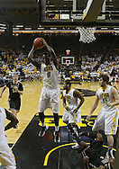 February 27 2013: Iowa Hawkeyes center Gabriel Olaseni (0) pulls in a rebound during the first half of the NCAA basketball game between the Purdue Boilermakers and the Iowa Hawkeyes at Carver-Hawkeye Arena in Iowa City, Iowa on Wednesday, February 27 2013.