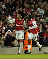 Photo: Olly Greenwood.<br />Arsenal v Newcastle United. The Barclays Premiership. 18/11/2006. Arsenal's Thierry Henry celebrates scoring with Emmanuel Adebayor