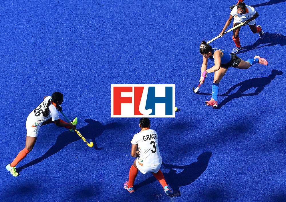 Argentina's Florencia Habif (R) runs to score during the women's field hockey Argentina vs India match of the Rio 2016 Olympics Games at the Olympic Hockey Centre in Rio de Janeiro on August, 13 2016. / AFP / MANAN VATSYAYANA        (Photo credit should read MANAN VATSYAYANA/AFP/Getty Images)