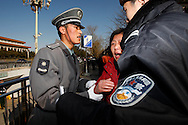 A Petitioner is taken away by police at Tiananmen square in Beijing, China, Thursday, March 5, 2009.While the nearly 3,000 delegates to the National People's Congress met, rings of uniformed and plainclothes police sealed off Tiananmen and kept ordinary Chinese and the normal hordes of tourists away. Police detained about two dozen people. Widespread frustration with the petition system is simmering and in several recent cases has boiled over, with a handful of people making desperate bids for attention.The peak season for the pilgrimages is the beginning of March, when China's lawmakers gather in the capital for their once-a-year legislative session. In an acknowledgement that the petition system is in crisis, China's Premier Wen Jiabao vowed to improve legal channels for grievances.