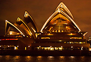 Sydney Opera House lit up in early evening, Sydney harbour, NSW, Australia