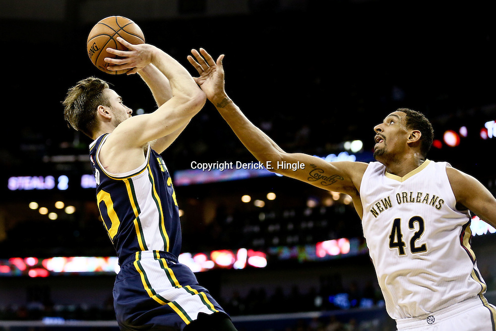 Feb 10, 2016; New Orleans, LA, USA; Utah Jazz forward Gordon Hayward (20) shoots over New Orleans Pelicans center Alexis Ajinca (42) during the second half of a game at the Smoothie King Center. The Pelicans defeated the Jazz 100-96. Mandatory Credit: Derick E. Hingle-USA TODAY Sports
