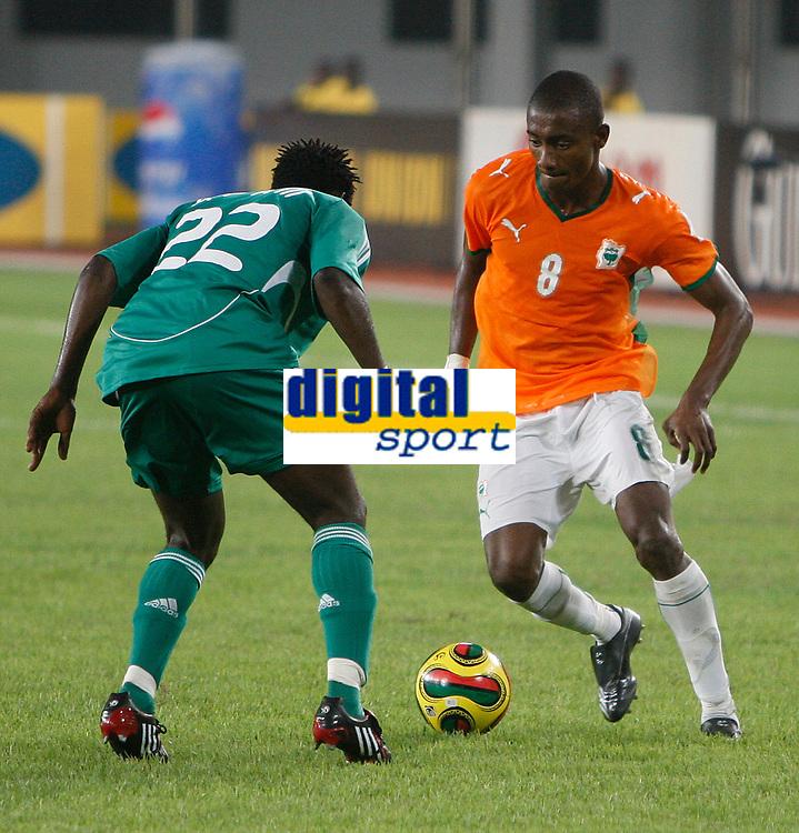 Photo: Steve Bond/Richard Lane Photography.<br />Nigeria v Ivory Coast. Africa Cup of Nations. 21/01/2008. Salomon Kalou (R) is held up by Apam Onyekachi (R)