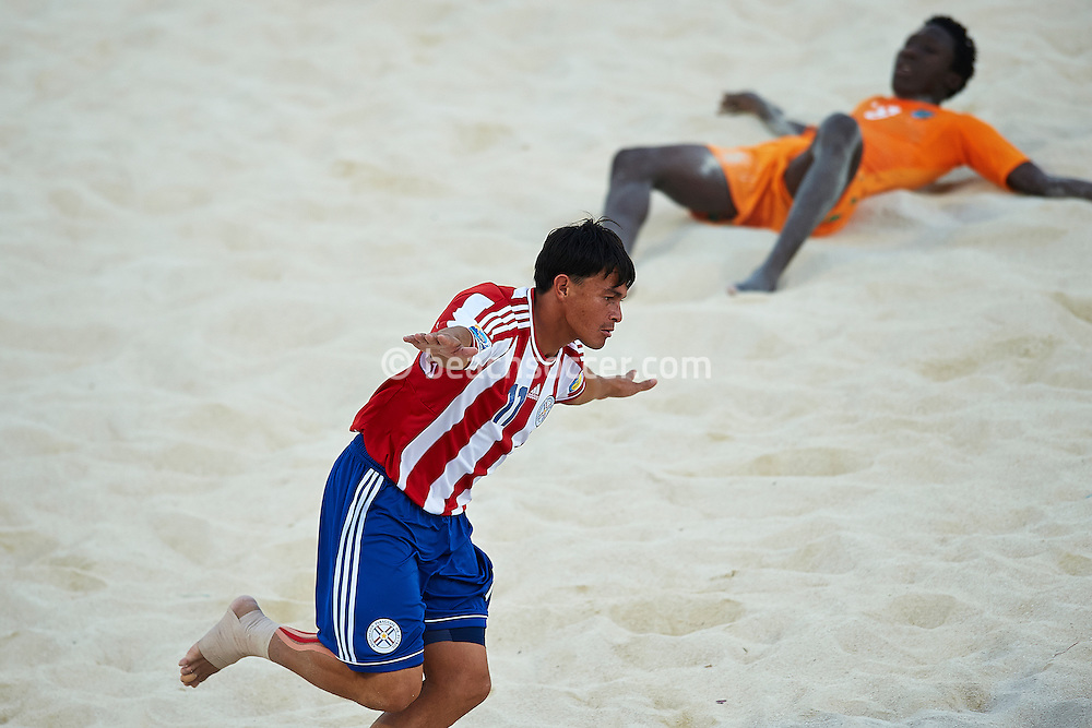 PAPEETE, TAHITI - OCTOBER 18:  FIFA Beach Soccer World Cup Tahiti 2013 between Paraguay and Cote D'ivoire at Stadium Tahua To´ata  on October 18, 2013 in Papeete, Tahiti. (Photo by Manuel Queimadelos)