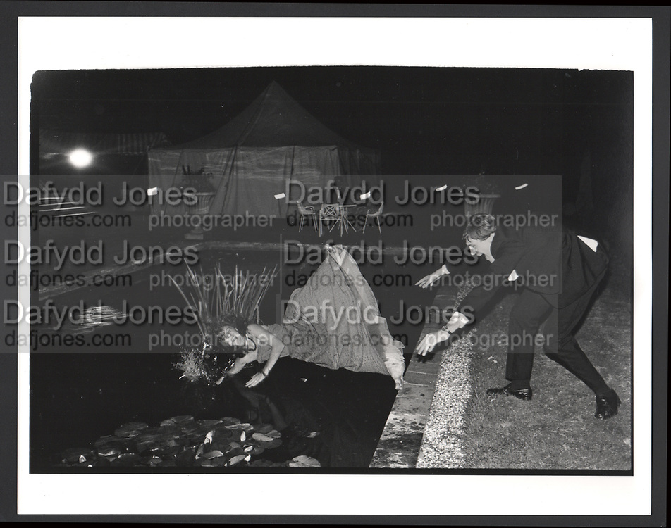 Debutante in a lily pond, Pop Vincent pushed in by Charles Mcdowel during the Martin Betts Dance. Ascot. 23 July 1982Exhibition in a Box