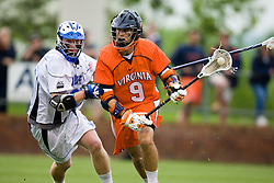 Virginia attackman Danny Glading (9) beats Duke defenseman Parker Mckee (35).  The #2 ranked Duke Blue Devils defeated the #3 ranked Virginia Cavaliers 11-9 in the finals of the Men's 2008 Atlantic Coast Conference tournament at the University of Virginia's Klockner Stadium in Charlottesville, VA on April 27, 2008.