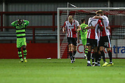 Cheltenham Town players celebrate Cheltenham Town's Freddie Hinds(27) goal after a mistake by Forest Green Rovers Drissa Traoré(4) during the EFL Trophy match between Cheltenham Town and Forest Green Rovers at Whaddon Road, Cheltenham, England on 3 October 2017. Photo by Shane Healey.