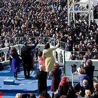 The First Family waves to the crowd after the Inauguration of President Barack Obama as the 44th President of the United States of America. US Capitol, Washington, DC. 1/20/09. Photo by Lisa Quinones/Black Star.