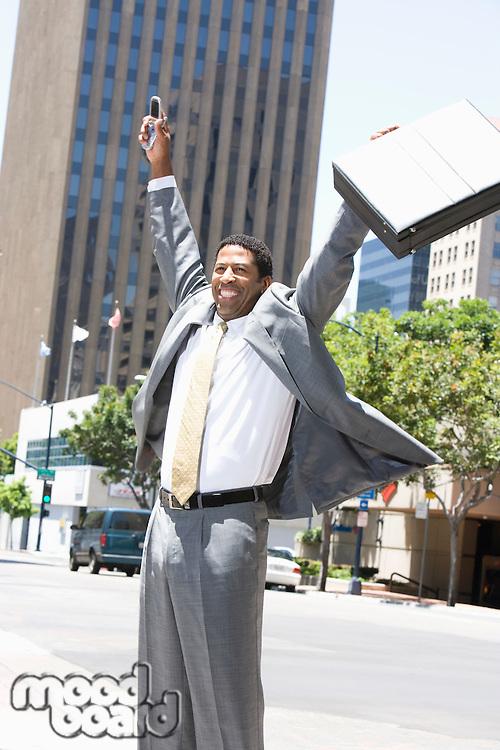 Businessman celebrating at street