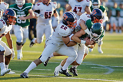 {BLOOMINGTON, IL: Daniel Herber and Caden Sigler double up on the tackle of Dean Zigulich during a college football game between the IWU Titans  and the Wheaton Thunder on September 15 2018 at Wilder Field in Tucci Stadium in Bloomington, IL. (Photo by Alan Look)