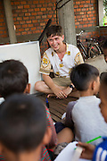 ICS volunteers  Dan Hensman runs a weekly English class for all children in the village at their host home, in the village of in Banteay Char, near Battambang, Cambodia.