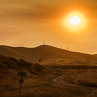 Sunset in a smoke filled sky in central California.  2016 was a bad year for forest fires, and this photo shows an all to common scene.