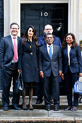 © Licensed to London News Pictures. 23/01/2016. London, UK. Amal Clooney and her client deposed former president of the Maldives Mohamed Nasheed (C) leaving Downing Street after a meeting with David Cameron on Saturday, 23 January 2016. Photo credit: Tolga Akmen/LNP