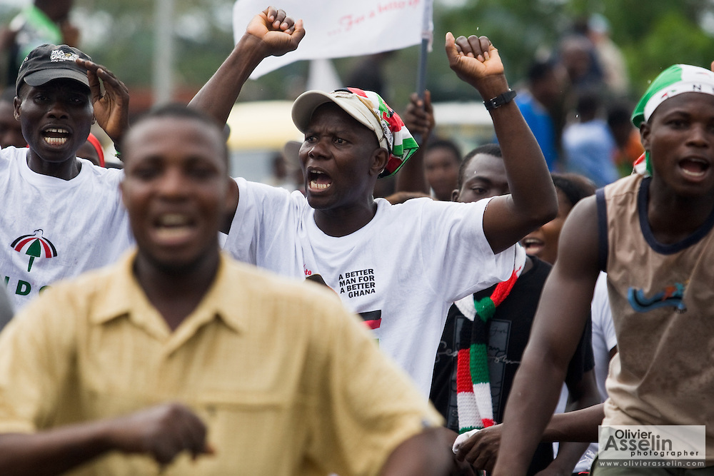 Supporters of the National Democratic Congress (NDC), Ghana's official opposition party, cheer during a rally in Tema, roughly 30km east of Ghana's capital Accra on Friday December 5, 2008. Ghanaians are voting in a presidential election on December 7 as incumbent John Agyekum Kufuor, leader of the New Patriotic Party (NPP),  is to step down after ruling for 2 consecutive 4-year terms.