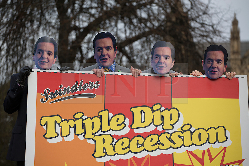 © licensed to London News Pictures. London, UK 05/12/2012. Unison representatives posing in George Osborne masks ahead of Autumn Statement, calling on the Chancellor to act now to avoid a triple dip recession outside the Houses of the Parliament. Photo credit: Tolga Akmen/LNP