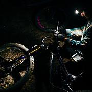Rex Flake riding single track after dark in Leavenworth, Washington.