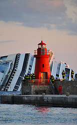 "Rescue workers look at The Wrecked Cruise Ship ""Costa Concordia"" in Giglio, Italy, Photo By Nick Cornish/ I-Images."