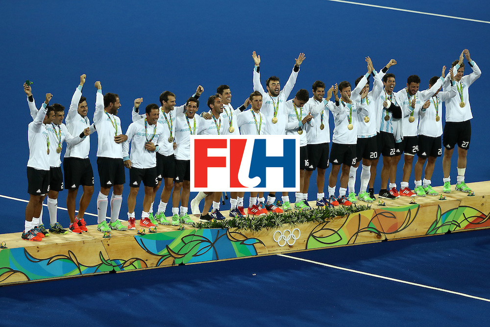 RIO DE JANEIRO, BRAZIL - AUGUST 18:  Team Argentina pose on the podium during the medal ceremony for the Men's Hockey Gold Medal match between Belgium and Argentina on Day 13 of the Rio 2016 Olympic Games at Olympic Hockey Centre on August 18, 2016 in Rio de Janeiro, Brazil.  (Photo by Sean M. Haffey/Getty Images)