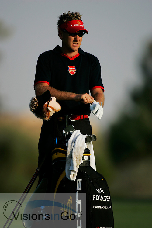 Ian Poulter with an Arsenal shirt on <br /> Dubai Desert Classic, Emirates GC, UAE. 2nd Febraury 2006, day 1<br /> Mandatory Photo Credit: Mark Newcombe / visionsingolf.com