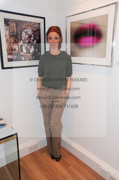 TAMARA BECKWITH at a private view of photographs held at the Little Black Gallery, Park Walk, London on 20th January 2010.