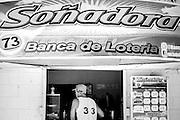 Pueblo Juanillo es un pequeño asentamiento construido artificialmente para alojar a 40 familias que fueron desplazadas de su emplazamiento natural frente al mar en la zona que hoy ocupa el resort más lujoso del sector turistico en todo el Caribe, Cap Cana; a escasos kilometros está Punta Cana, el primer resort que se desarrolló en la zona y que da su nombre a este destino turístico de renombre mundial. El asentamiento original estaba situado a la orilla del mar y sobrevivía principalmente de la pesca. En el año 2002, y para construir un restaurante de playa, los propietarios del proyecto Cap Cana ofrecieron a los  habitantes un pueblo nuevo con casas prefabricadas, servicios básicos y una mejor calidad de vida, a tan solo a tres kilometros del antiguo, pero alejado de la costa. El acceso a la zona donde pescaban quedó restringido, con lo que perdieron su sustento tradicional, y muchos se marcharon del pueblo. Los que llegaron fueron mayoritarimente gente de otras zonas del país en busca de una oportunidad en la industria turística de la zona, como vigilantes de seguridad o jardineros. Los servicios dejaron de suministrarse poco a poco y el pueblo ha sobrevivido entre suciedad, cortes de luz, e incomunicación por más de diez años.  Actualmente se empieza a gestionar gracias a diversos organismos locales, promotores y ONGs una ayuda para volver a integrar a estas personas en el medio y proporcionar a sus hijos una educación suficiente mediante la escuela, que los acoge solamente desde el 2010. Editorial and Commercial Photographer based in Valencia, Spain |Portraits, Hospitality, News, Sports, Media Coverage for Events
