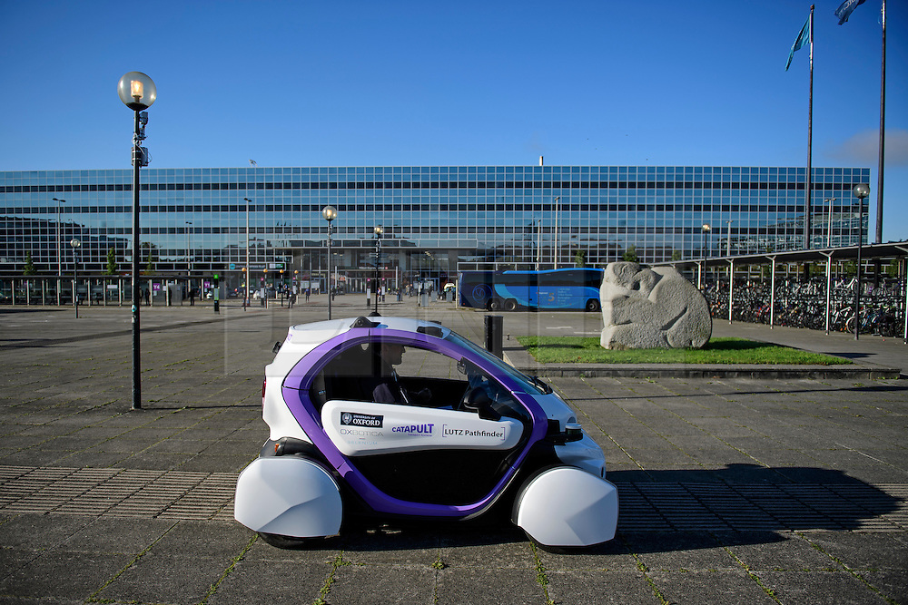 © London News Pictures. 11/10/2016. Milton Keynes, UK. A driverless car being tested around pedestrian areas in Milton Keynes in the first public test of autonomous electric vehicles in the UK. The vehicles have been developed by the Oxford Robotics Institute and Oxbotica. Photo credit: Ben Cawthra/LNP