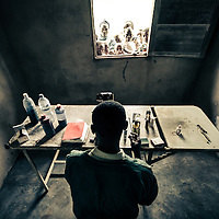 A laboratory technician works in a rural clinic near Mbuji-Mayi, DRC.