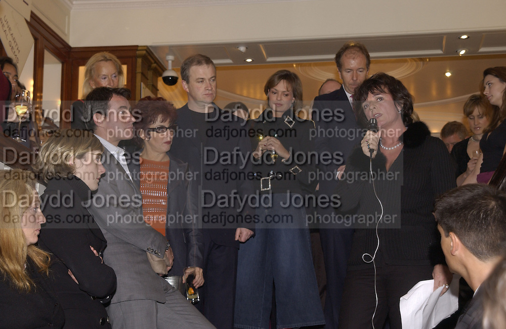 Tim Jeffries,  Ruby WaX,  Harry enfield, Maya von Schonburg and  Charlotte Monckton.  Charity sale of the last ever sale at Asprey and Garrard. New Bond St. London. 15/1/02© Copyright Photograph by Dafydd Jones 66 Stockwell Park Rd. London SW9 0DA Tel 020 7733 0108 www.dafjones.com