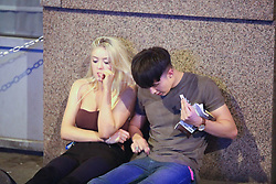 MANCHESTER 19.09.2017:  A girl looks unhappy as her  male points to his jeans!<br /> <br /> Freshers week continues in Manchester which has seen 1000s of students out drinking every night since Sunday.