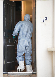 © Licensed to London News Pictures. 21/09/2017. London, UK. A police forensics officer enters a property in Thornton Heath, south London where a 17 year old was arrested last night. This is the sixth arrest in connection with the bombing of an underground train at Parsons Green on September 15th. The bomb failed to fully explode but still injured 30 people. Photo credit: Peter Macdiarmid/LNP
