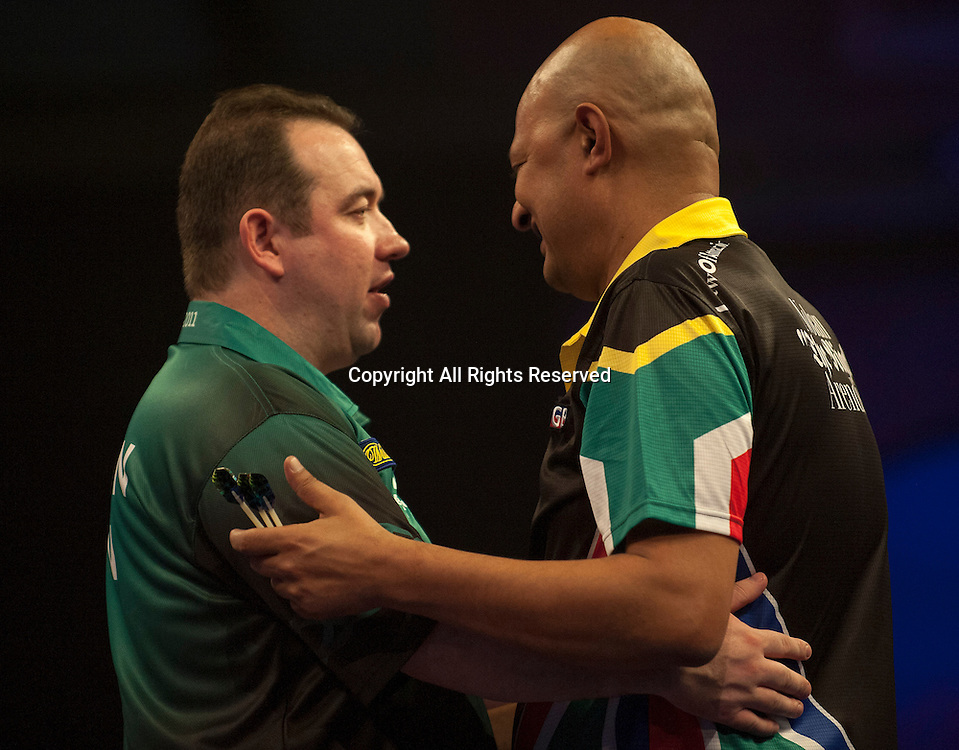 22.12.2014.  London, England.  William Hill PDC World Darts Championship.  Brendan Dolan (11) [NIR] shakes hands with Nolan Arendse [RSA]  after their  match.  Dolan won the match 3-0