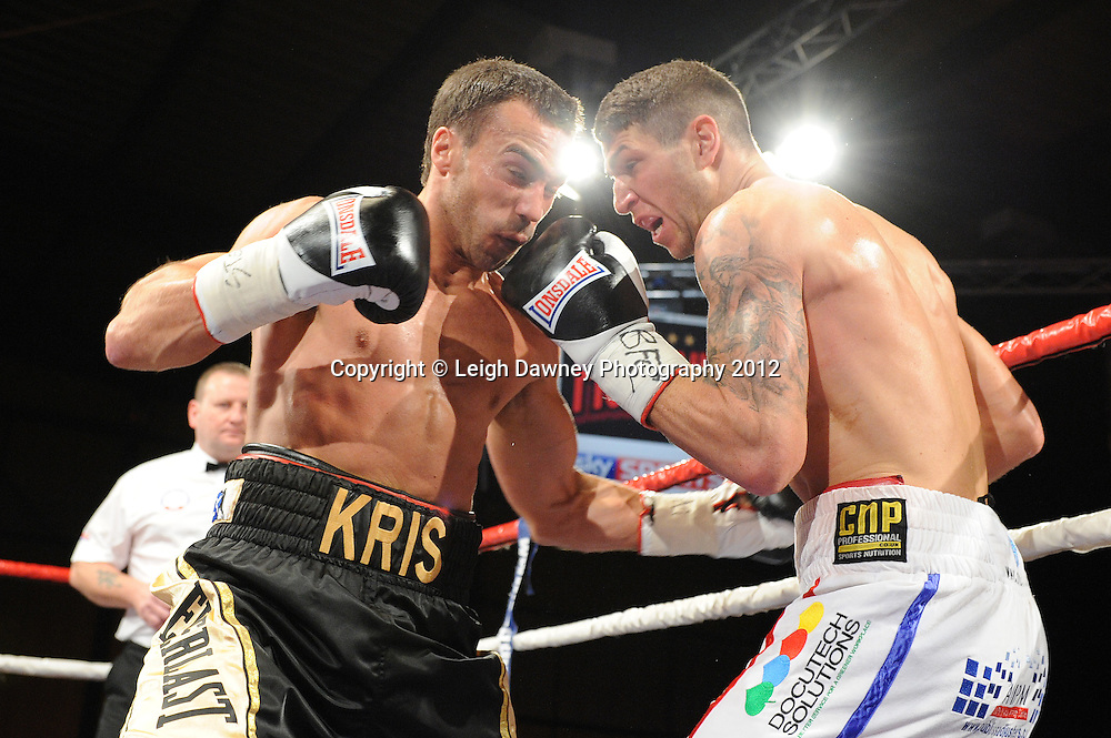 Brian Rose (white shorts) defeats Kris Carslaw in a 12x3 contest for the British Light Middleweight Title at the Bowlers Exhibition Centre, Manchester, on the 2nd June 2012. Frank Maloney Promotions © Leigh Dawney Photography 2012.