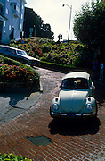"Classic VW Bug turning one of the many curves of Lombard Street, ""the crookedest street in the U.S. Lombard Street is best known for the one way section on Russian Hill between Hyde and Leavenworth Streets, in which the roadway has eight sharp turns (or switchbacks) that have earned the street the distinction of being ""the crookedest [most winding] street in United States."" San Francisco, California..Subject photograph(s) are copyright Edward McCain. All rights are reserved except those specifically granted by Edward McCain in writing prior to publication...McCain Photography.211 S 4th Avenue.Tucson, AZ 85701-2103.(520) 623-1998.mobile: (520) 990-0999.fax: (520) 623-1190.http://www.mccainphoto.com.edward@mccainphoto.com."