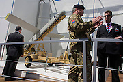 A soldier from the British Royal Artillery demonstrates details of Fire Shadow missile on MBDA's trade stand at Farnborough airshow. The so-called lurker bomb is designed to loiter above a battlefield for up to 6 hours before attacking stationary or mobile targets and also able to shadow British troops for up to ten hours or 100 miles, ready to take out enemy targets with surgical precision at a minute's notice..