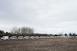 © Licensed to London News Pictures. 02/03/2016. Calais, France. A long line of police vehicles at the migrant camp knows as 'The Jungle' in Calais, France, where part of the camp is currently being cleared by French authorities. Violence has broken out in parts of the eviction zone where inhabitants have resisted efforts to move them. Photo credit: Rob Pinney/LNP