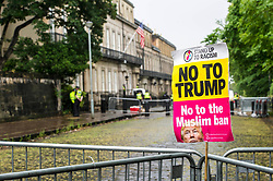 Pictured: <br /> A protest outside the American consulate in Edinburgh turned out to be a bit of a let down with only one protester making his presence felt.  He was outnumbered by the police but about 80-1.  The barriers in place were left dripping wet as were the police without having to deal with protesters.<br /> <br /> Ger Harley | EEm 13 July 2018