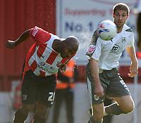 Photo: Daniel Hambury.<br />Brentford v Bristol City. Coca Cola League 1. 07/10/2006.<br />Brentford's Clyde Wijnhard gets to this ball ahead of Bristol City's Jamie McCombe.