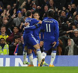 Chelsea's Eden Hazard celebrates his goal with Chelsea's Cesar Azpilicueta and Chelsea's Didier Drogba. - Photo mandatory by-line: Dougie Allward/JMP - Mobile: 07966 386802 - 03/12/2014 - SPORT - Football - London - Stamford Bridge - Chelsea v Tottenham Hotspur - Barclays Premier League