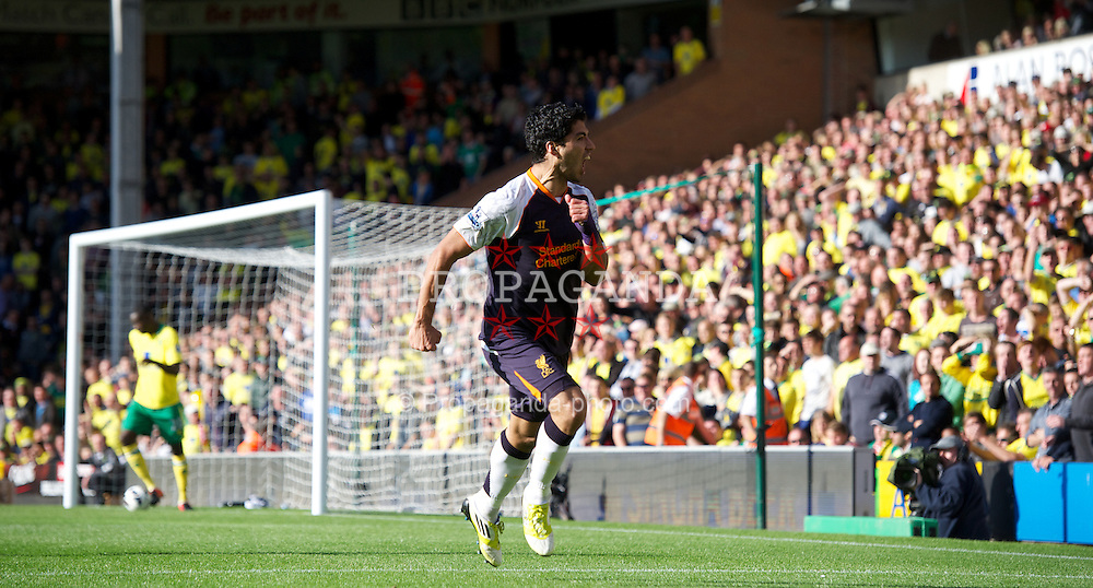 NORWICH, ENGLAND - Saturday, September 29, 2012: Liverpool's Luis Alberto Suarez Diaz celebrates scoring the second goal of his hat-trick against Norwich City during the Premiership match at Carrow Road. (Pic by David Rawcliffe/Propaganda)