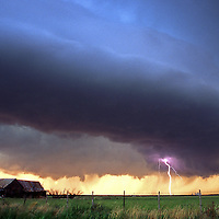 Supercell thunderstorm with lightning over an abandoned house in west Texas.