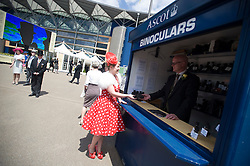 © licensed to London News Pictures. 14/06/2011. Ascot, UK.  Natalie Turner buying binoculars on day one at Royal Ascot races today (14/03/2011). The 5 day showcase event,  one of the highlights of the racing calendar is in it's 300th year. Horse racing has been held at the famous Berkshire course since 1711 and tradition is a hallmark of the meeting. Top hats and tails remain compulsory in parts of the course. Photo credit should read: Ben Cawthra/LNP