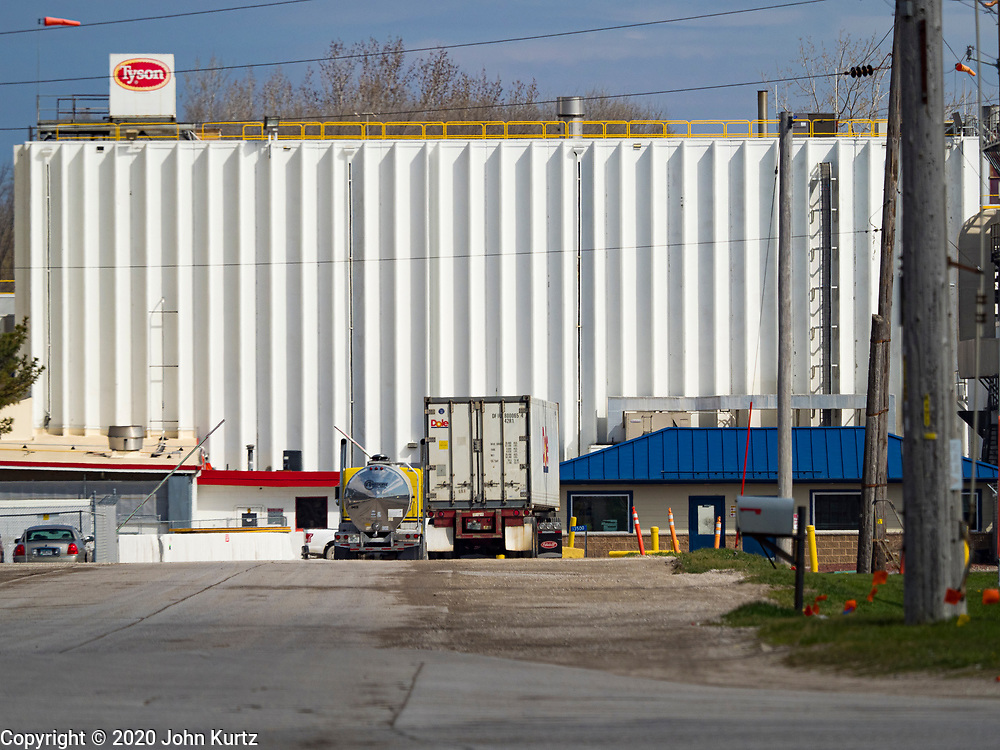 """20 APRIL 2020 - PERRY, IOWA:  The main entrance to the Tyson Foods pork processing plant in Perry, IA. The Tyson pork processing plant in Perry reported over the weekend that at least two dozen workers had tested positive for COVID-19. The plant is closed Monday, April, 20 for a thorough cleaning and sanitization. At least five meat packing plants in Iowa have reported outbreaks of COVID-19. In addition to the five plants in Iowa, meat packing plants close to Iowa in Nebraska, South Dakota, and Minnesota have reported outbreaks of COVID-19 (SARS-CoV-2, Coronavirus). The Tyson plant has more than 1,400 workers and is the largest single employer in Perry. The state of Iowa has begun providing surveillance testing of meatpacking plants to more broadly test employees even if they are not experiencing symptoms of COVID-19. State """"strike teams"""" made up of an epidemiologist, an infectious disease nurse and other personnel will advise facilities of preventative measures to take and administer contact tracing to determine who may have been in contact with any infected individual. The state of Iowa has begun providing surveillance testing of meatpacking plants to more broadly test employees even if they are not experiencing symptoms of COVID-19. State """"strike teams"""" made up of an epidemiologist, an infectious disease nurse and other personnel will advise facilities of preventative measures to take and administer contact tracing to determine who may have been in contact with any infected individual.     PHOTO BY JACK KURTZ"""