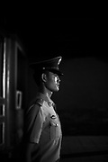 A Chinese soldier stands guard at night in the Forbidden City in Beijing.
