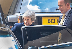 © Licensed to London News Pictures. 16/05/2019. London, UK. Prime Minister Theresa May is watched by her close protection officer as she leaves Parliament after meeting with the backbench 1922 committe. Photo credit: Peter Macdiarmid/LNP