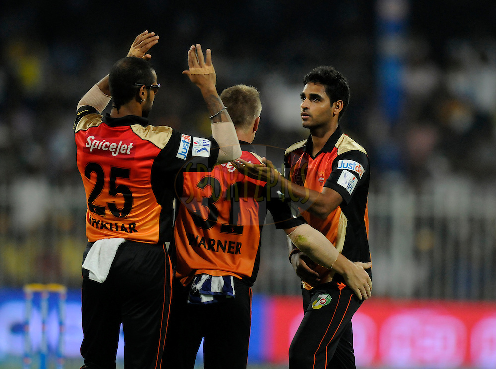 Bhuvneshwar Kumar of the Sunrisers Hyderabad celebrates the wicket of Dwayne Smith of The Chennai Superkings during match 16 of the Pepsi Indian Premier League 2014 between the Delhi Daredevils and the Mumbai Indians held at the Sharjah Cricket Stadium, Sharjah, United Arab Emirates on the 27th April 2014<br /> <br /> Photo by Pal Pillai / IPL / SPORTZPICS