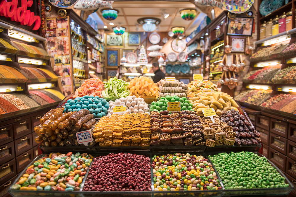 Well ordered shelves of delicious candies and confections entice shoppers at storefront in Istanbul Spice bazaar in Turkey