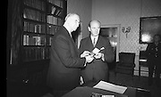The new Taoiseach, Jack Lynch, recieves his seal of office from President Eamon de Valera at &Aacute;ras an Uachtarain.<br /> 10.11.1966