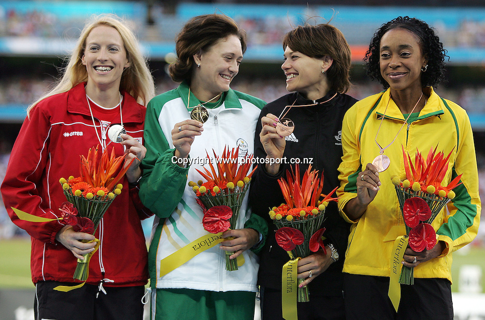 Bronze medal winner Angela McKee (NZL) and gold medal winner Anika Smith are all smiles on the podium after receiving their medals for the Women's High Jump final on Day 9 of the XVIII Commonwealth Games at the MCG, Melbourne, Australia on Friday 24 March, 2006. Photo: Hannah Johnston/PHOTOSPORT