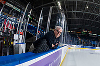 KELOWNA, CANADA - MARCH 2: Portland Winterhawks' equipment manager Mark 'Peaches' Brennan stands on the bench against the Kelowna Rockets on March 2, 2019 at Prospera Place in Kelowna, British Columbia, Canada.  (Photo by Marissa Baecker/Shoot the Breeze)